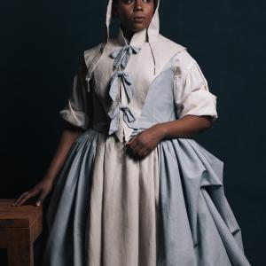 The Crucible character Elizabeth Proctor in a white and blue dress