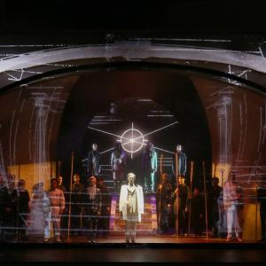 A panoramic of the stage including projections of architecture