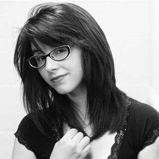 woman with glasses and dark hair