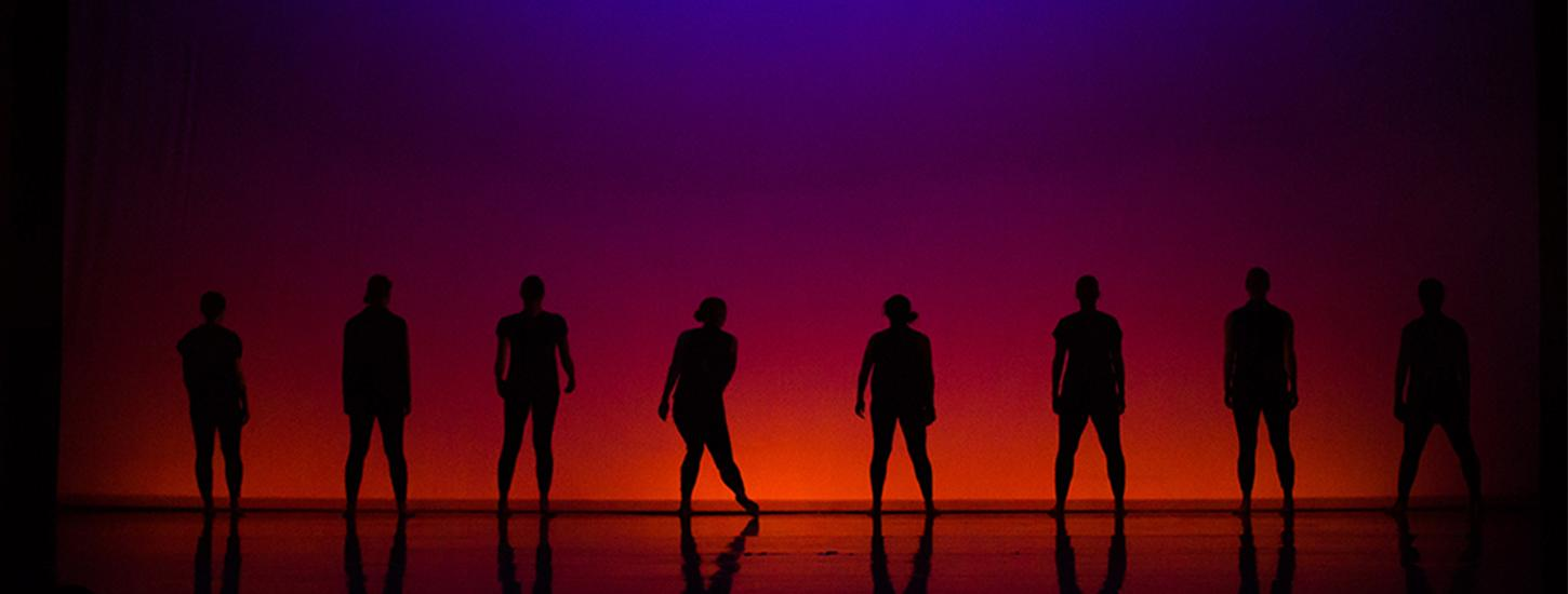 Dancer silhouettes on stage