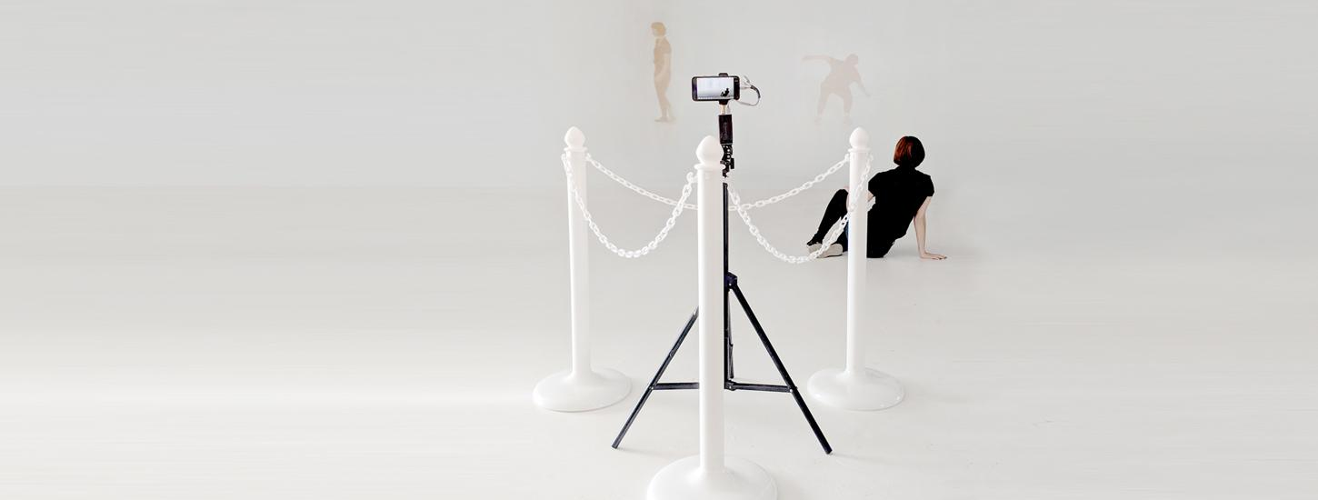 camera phone on tripod with three dancers in front of it