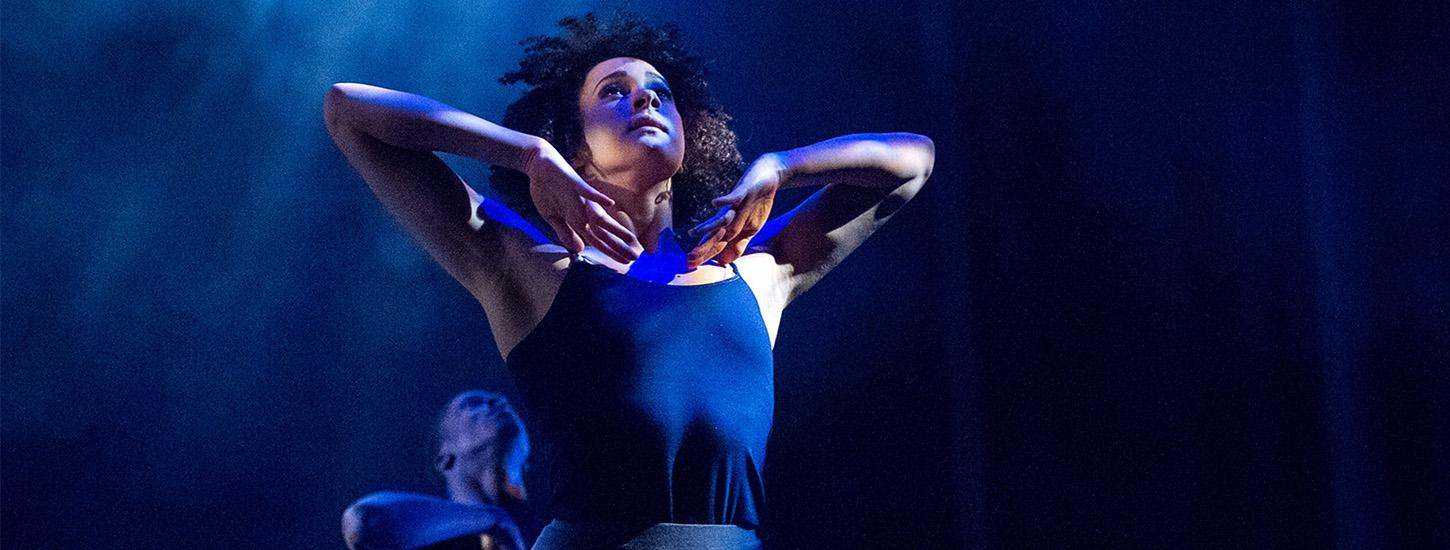 female dancer, arms at collarbones looking up