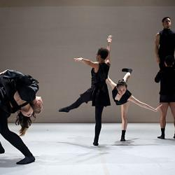 drt momentum in black dancers in front of white screen