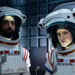 two astronauts in their gear looking at the camera