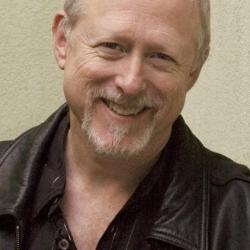 man in leather jacket smiling