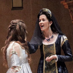woman in shakespearean clothes speaking with another woman